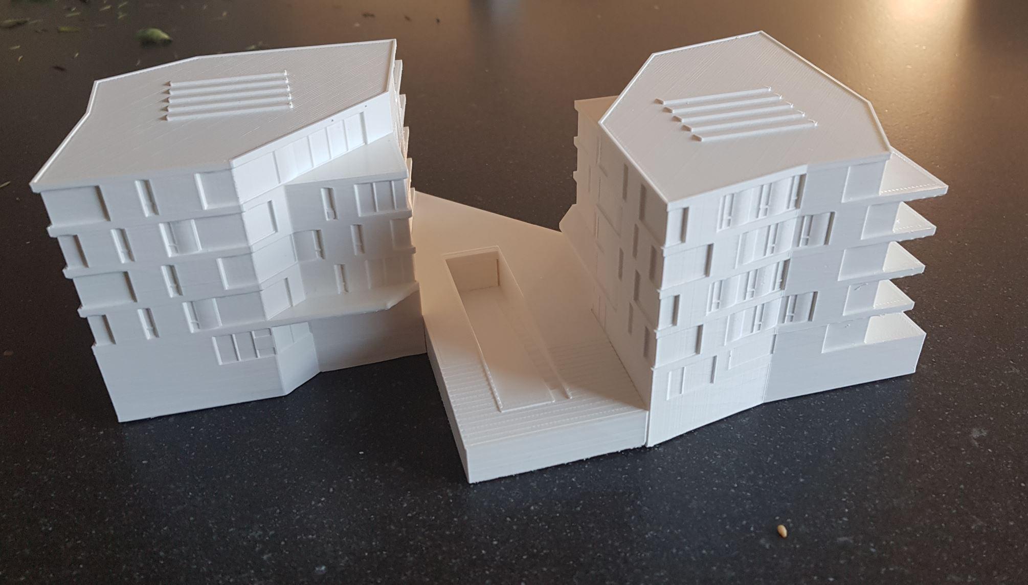 de twee gebouwen van 'de Parkwachter'; met daartussen een stukje van de parkeergarage